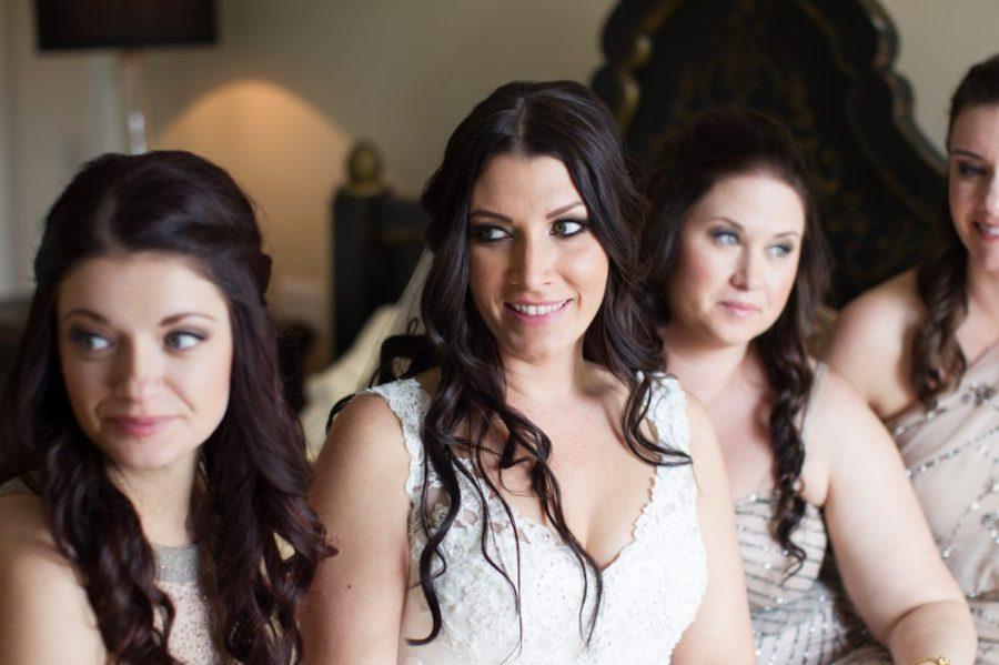 Bride with bridesmaids behind her before wedding ceremony